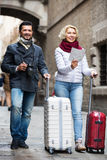 Tourists with map and luggage Royalty Free Stock Image