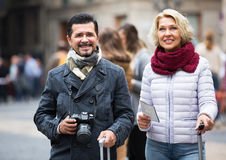Tourists with map and luggage Royalty Free Stock Photo