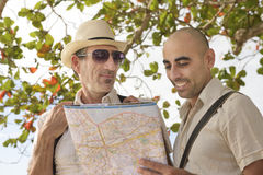 Tourists with map. Sightseeing: Two mature male tourists holding map Royalty Free Stock Image
