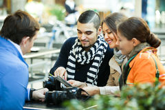 Tourists with map at street cafe Royalty Free Stock Photography