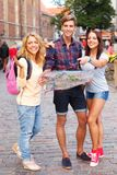 Tourists with map Royalty Free Stock Photos