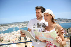 Tourists with map visiting Royalty Free Stock Photo