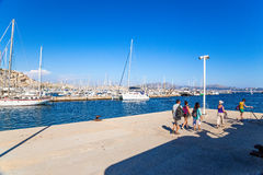 Tourists in the marina on the archipelago of Friuli, France Royalty Free Stock Photos