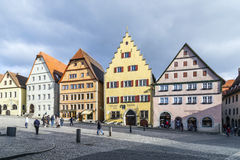 Tourists at the market place of Rothenburg ob der Tauber Stock Image