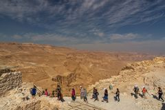 Tourists at Masada Fortress, National Park,Judea, Israel. Tourists at Masada Fortress, National Park,Judea, West Bank, Israel, Middle East. 2017 royalty free stock image