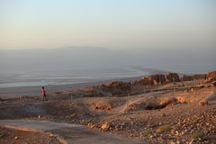 Tourists in Masada looking at Dead Sea Stock Image