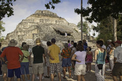 Tourists at the Mayan ruins at Chacchoben Mexico. Cruise ship tourists visiting the Chacchoben Mayan ruins site. It is a large collection on Mayan pyramid ruins Royalty Free Stock Photography
