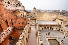 Tourists in maze of red and pink sandstone in Jaipur Stock Photos