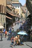Tourists on the medieval bridge Ponte Vecchio Stock Photos