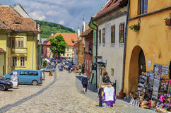Tourists on medieval street in Sighisoara, Romania royalty free stock photo