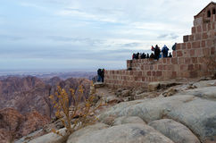 Tourists meet dawn on Mount Moses, Sinai Mountains, Egypt Royalty Free Stock Photography