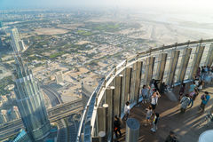 Tourists meet sunrise at the observation deck on the 125 floor of Khalifa tower Royalty Free Stock Images