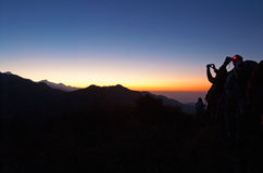 Tourists meet the sunrise at top of Poon Hill, Nepal Stock Image