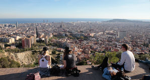 Tourists meet to watch Barcelona views from nearby hill Stock Photos