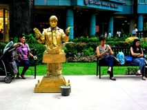 Tourists and a mime in a Park in Eastwood City Royalty Free Stock Photo