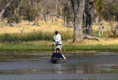 Tourists on a mokoro canoe in Botswana Stock Image