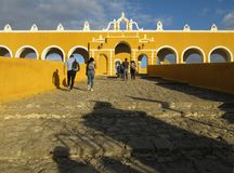 Tourists at the Monastery of Izamal Front Entrance. Photo of the front entrance of the monastery of izamal and tourists on 1/13/18 in izamal yucatan mexico Stock Photos
