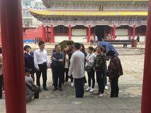 Tourists. In the monuments of Taoism, tourists are listening priests to the tour guide Stock Photo