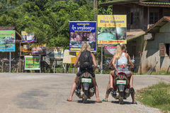 Tourists at a motorbike Royalty Free Stock Photo