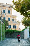 Tourists on motorcycle in street at historical part of Sorrento. Tourists on motorcycle in the street at historical part of Sorrento, Amalfi coast, Italy stock images