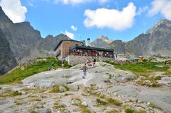 Tourists at the mountain chalet. Stock Images
