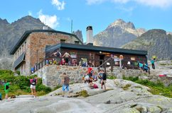 Tourists at the mountain chalet. Royalty Free Stock Images