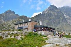 Tourists at the mountain chalet. Stock Photos