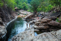 Tourists on a mountain lake on the island of Koh Chang in Thaila. KOH CHANG, THAILAND - 27 MARCH, 2015: Tourists on a mountain lake Stock Photo