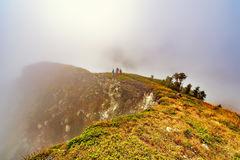 Tourists on the mountain meadow. Royalty Free Stock Images