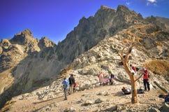 Tourists on mountain pass. Royalty Free Stock Photos