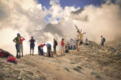 Tourists on mountain pass. Royalty Free Stock Photography