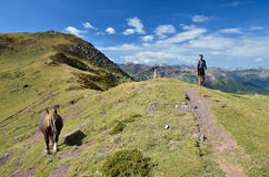 Tourists in the mountain passage in the Atlantic Pyrenees Royalty Free Stock Photography