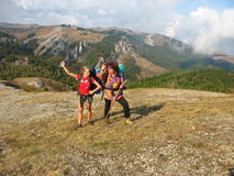 Tourists on a mountain plateau Royalty Free Stock Photography