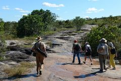 Tourists on a mountain river Canio Cristales. Royalty Free Stock Image