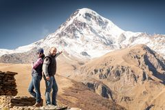 Tourists, mountains, funny Royalty Free Stock Image