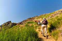 Tourists in mountains Stock Photos