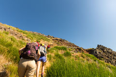 Tourists in mountains Stock Images