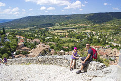 Tourists in Moustiers-Ste-Marie. Alpes de Haute Provence Royalty Free Stock Images