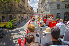 Tourists  moving on two-deck tourist bus in Budapest. Budapest, Hungary- 20 July, 2016: Tourists  moving on two-deck tourist bus and visiting the sights of Royalty Free Stock Photography