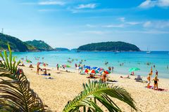 Tourists on the Nai Harn beach Royalty Free Stock Photography