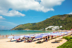 Tourists on the Nai Harn beach Royalty Free Stock Images