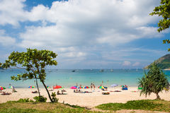 Tourists on Nai Harn beach Stock Image