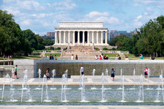 Tourists at the National Mall in Washington D.C. WASHINGTON D.C.,USA - AUGUST 14, 2016 : Tourists at the National Mall in Washington D.C. with a view of the Stock Photo