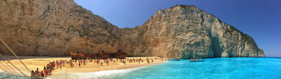 Tourists in Navagio Bay with Wrecked Ship stock photography