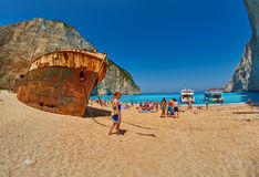 Tourists in Navagio Bay, Zakinf Island, Greece Royalty Free Stock Image
