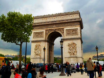 Tourists near Arc de Triomphe on Champs Elysees Stock Images