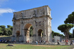 Tourists near the Arch of Constantine in Rome. Rome, Italy - August 17, 2015: Tourists near the Arch of Constantine in sunny day Royalty Free Stock Image