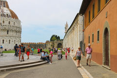 Tourists near the Baptisery of St. John in Pisa, Italy Royalty Free Stock Image