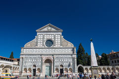 Tourists near Basilica of Santa Maria Novella, Florence, Italy. Stock Photo
