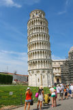 Tourists near the bell tower of the Cathedral (Leaning Tower of Stock Image